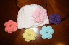 Hat with 3 interchangeable flowers by amosmom on Etsy, $10.00