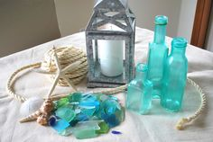 Sea Glass Bottles from mod podge (or watered down Elmer's glue) and food coloring Painted Glass Bottles, Glass Bottle Crafts, Sea Glass Crafts, Bottles And Jars, Bottle Art, Glass Jars, Paint Bottles, Mason Jars, Decorated Bottles