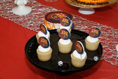 Cupcakes with FC Barca toppings for kids soccer birthday parties.