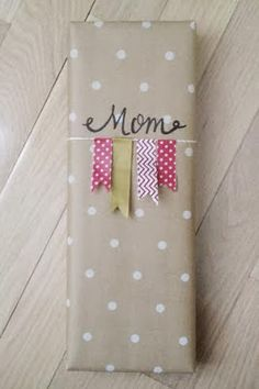 pretty packages with white polka dots on Kraft wrapping paper with a garland of Washi tape flags