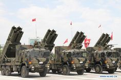 Turkish Army T-300 Kasırga multiple rocket launchers rolling through the Atatürk Cultural Center at the 2013 Turkish Victory Day Parade.