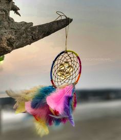 """Multicolored dreamcatcher mirror hanging.. This dreamcatcher is 3"""" in diameter and is perfect for your vehicle's rearview mirror! • Picture courtesy: @aneespatel109 