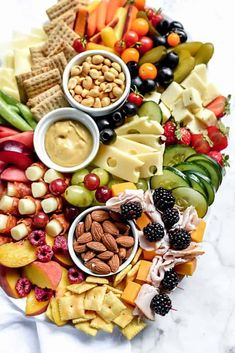 charcuterie board with pepperoni-wrapped mozzarella sticks cheeses crackers nuts veggies and mustard Charcuterie And Cheese Board, Charcuterie Platter, Antipasto Platter, Cheese Boards, Snack Platter, Platter Ideas, Snacks Für Party, Appetizers For Party, Appetizer Recipes