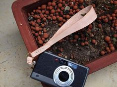 Personalized Camera Wrist Strap - Leather - Hand Stitched. $65.00, via Etsy.