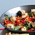 dinner tonight:  spicy thai tofu with red peppers and peanuts.  Quick, and hits all the thai flavors