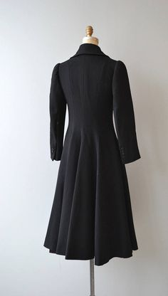 Vintage 1970s Luba black wool princess coat with a pronounced 1930s inspiration, large rounded collar, slender sleeves, gorgeous princess shape with gentle folds from low back to the hem, hip pockets and satin lining.  --- M E A S U R E M E N T S ---  fits like: small shoulder: 13.75 bust: