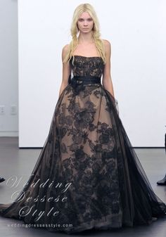 Vera Wang.     I've never considered wearing any other color for a wedding but white or ivory, but this dress is romantic and beautiful. Wonder if it does come in ivory or white...Humnn....