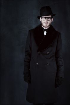 Shades of Black, Double Breasted Top Coat, Bow Tie, and Felt Hat, by Berluti. Men's Fall Winter Fashion.