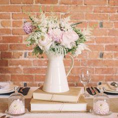 cream metal jugs wedding table decorations