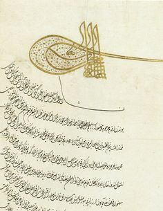 """This royal decree, or ferman, features 24 lines of divani script written in sefine (""boat"") form, in black ink powdered with gold. It bears the seal, or tugra, of Sultan Suleyman the Magnificent."""