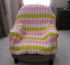 Get your home ready for spring with this All a Flutter Afghan.  With a fun stitch that looks similar to butterfly wings, this lovely crocheted afghan pattern makes a wonderful addition to a baby's room or nursery.