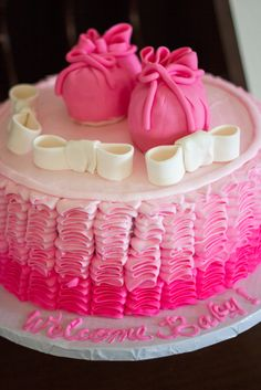 Pretty pink ombre ruffle cake at a girl baby shower!  See more party ideas at CatchMyParty.com!