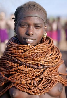 Africa | Nyangatom woman wearing numerous strands of beads made from wood.  Omo River, southwest Ethiopia | ©Nigel Pavitt / John Warburton-Lee