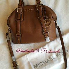 """MICHAELMichael Kors Bedford Med. Leather Satchel MICHAEL Michael Kors Bedford Satchel is a classic piece. Soft leather that has a slightly slouched silhouette. Can be carried by the handles or wear on the shoulder. 100% Cow Leather. Gold Tone Hardware. Top handle: 5"""" Adjustable strap 13""""-15"""" Interior: one Zip pocket, three open pockets. Top Zip closure. Interior lining: 100% Polyester. Imported.  NO TRADES OR PP  Reasonable offers are welcome  MSRP: $398 + Tax. Color: Brown sold out online…"""
