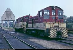 TH&B SW9 no. 56 and GP7 no. 75 idle at their Hamilton, ON engine facility. SW9 56 was built by General Motors Diesel Division, London, ON in December 1950 and sold to Atlas Steel, Welland, ON for scrap in May 1988. It was resold several times since, last reported in Belledune, New Brunswick in March 2006. The no. 75 was equipped with Automatic Train Control so it could run on the point on NYC trains east of Welland, ON. The unit was rebuilt by CP as CP1685, a GP7u in February 1988.