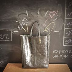 Step by step photos to help you make your own simple leather tote.