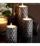 "What a great idea! Looks like pillar candles and uses tealights!    Signature Elevated Tealight Trio  Item #: P99002  Exclusive diamond pattern sets an elegant stage for tealights or large tealights, sold separately. The holders are the same size as our round pillars – anywhere you can use a round pillar you can use these holders. Glazed ceramic with a metallic finish. Includes one each of three heights: 3"", 5"" and 7"", 3"" dia.  Price:   $50.00/set of 3 SHOP:  www.partylite.biz/madeforyou"