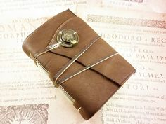 A Golden Leather Bookmark with your name engraved on it and a Key Ring Holder also as a Gift…  Leather Journal Rustic Style Handbound Notebook by ArtNotebooks, $59.00