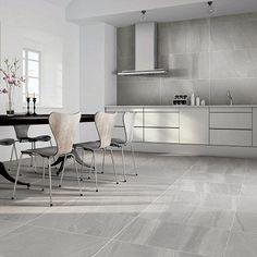 This modern kitchen features Porcel-Thin LASCAR grey blue volcanic ash effect thin porcelain tiles in a matt finish. Porcelain, Grey Marble Tile, Marble Tile Kitchen, Large Floor Tiles, Tiles, Large Tile, Porcelain Tile, Modern Kitchen, Kitchen Tiles