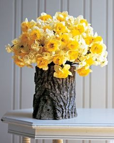 drill a hole in a log, add a glass jar and you have a beautiful natural vase. LOVE this idea!!.