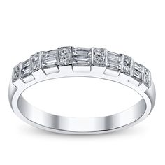 They Come Together 'Cause Opposites Attract. Jeans and heels. You can always pull together two different looks (and make it work!) This modern 14K white gold wedding ring is for you. Each baguette diamond, like a clear pool of water, is set between the fire of a round diamond. The contrast is stunning. Fire and water working in perfect harmony.