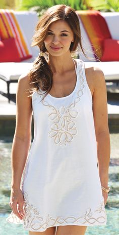 This Mud Pie White Jessa Twill Cover Up is a sleeveless racer back dress with natural twill tape detail at neck and hem has breezy side slits. This dress is a a flattering racerback tank with relaxed a-line silhouette.