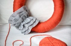 yarn wreath with ruffle... i'll have to figure out a no sew ruffle!