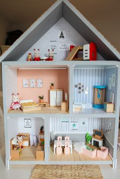 As soon as I saw  this dollhouse by Lia Griffith  as I was scrolling through Pinterest one day, I knew I wanted to create something simila...