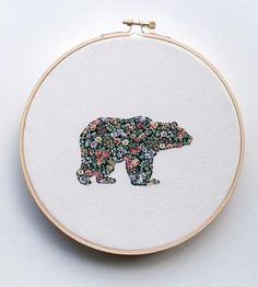 This handmade wall art features a sprightly bear silhouette, made from vintage floral fabric and carefully embroidered onto ivory fabric using a machine. The bear art is made just for you, so treat it well.