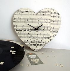 Music note wall clock....I wonder how difficult this would be to make...maybe with the sheet music for Amazing Grace or The Old Rugged Cross...