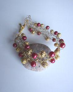 bracelet doré avec perles rouges et or fil. par ManuelledeParis