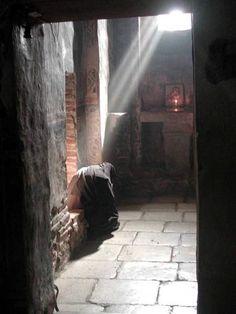 Serb nun praying at Gracanica Monastery, Serbia
