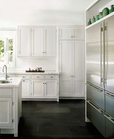 Remodeling 101 - How to choose a refrigerator - SubZero Refrigerator in White Kitchen, Remodelista