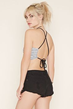 A stretch knit striped cami with a cropped hem and self-tie adjustable straps that crisscross at the back.