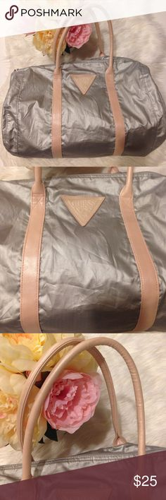 Guess Silver Pink Duffle Travel Bag Guess Silver Pink Duffle Travel Bag. Zipper closure, pink cloth lining, Guess patch logo. Silver nylon. Good condition, very clean Guess Bags Travel Bags