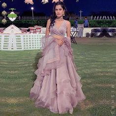 Looking like a surreal vision in our mauve layered organza lehenga with velvet wrap blouse and a ruffle dupatta!❤️ Mishru Wedding… is part of Dresses - Designer Party Wear Dresses, Indian Designer Outfits, Designer Wear, Indian Wedding Outfits, Indian Outfits, Indian Attire, Dress Wedding, Indian Wear, Lehnga Dress