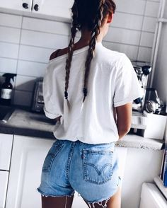 White tee. Cutoff shorts. Double braids
