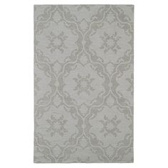 Anchor your living room seating group or define space in the den with this artfully handcrafted wool rug, showcasing a scrolling trellis motif for eye-catchi...