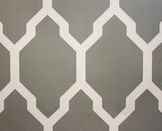 Tessella Wallpaper A large bold geometric repeat design in dark grey and white.