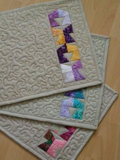 mug rug..but I like the color and free motion quilting for a table runner.