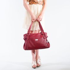 """Mary Red Casually chic, the Mary satchel bag will hold everything you need to take on the day. Crafted of faux leather and silver-toned hardware.  •  Faux leather •  17"""" L, 11"""" H, 5"""" W •  Handles with 10"""" drop •  Exterior pocket fits any Grace Adele Clutch"""
