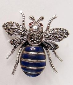 A Sterling Silver, Garnet, Lapis and Marcasite Bee