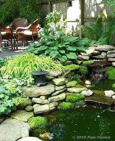 Water feature - Same area, different view, showing a sitting area strategically placed to enjoy the relaxing trickle of water from the waterfall. Looks like there is bamboo located in the background--a nice choice for this garden. Make sure to choose a clumping variety to avoid unwanted spreading. #Ponds