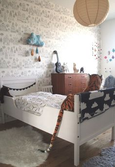Vintage inspired kids room / little boy's room -traditional boys colours, cloud patterns, vintage style wallpaper, and tiger!