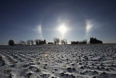 "A ""sun dog"" atmospheric phenomenon appears over a farm in southern Minnesota"
