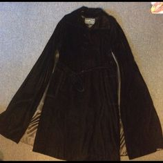 "Vintage Black Velvet Cape Coat Belted M L Very nice vintage black velvet cape coat. Attached cape and coat. Buttons at the top and belted - full coat with the cape attached. Nice dark black velvet - some pics were lightened so you could see the coat. Nice condition. I wear a 12 and this fits me nicely. Across the chest 19 1/2"" Length 43"" Vintage Jackets & Coats Capes"