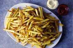 easier french fries...a Cook's Illustrated recipe via Smitten Kitchen. Use yukon gold potatoes and follow simple recipe. Happy husband!
