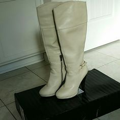 Victoria's Secret Boots Leather upper. Cream color. 4 1/2 inch heels. Only wore one time. I still have the box that goes with it. Victoria's Secret Shoes