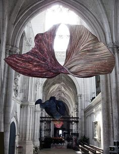 More than 100 of Peter Gentenaar's ethereal paper sculptures were hung inside the Abbey church of Saint-Riquier in France.    Peter's sculptures are created by allowing pulp to dry and shrink in unison whilst attached to bamboo framework. He says, The tension between the two materials transforms itself into a form reminiscent of a slowly curling autumn leaf.