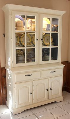 A china cabinet that was boring before but now it is fabulous! exterior is Old White and interior is Napoleon Blue, both are Annie Sloan Chalk Paint.